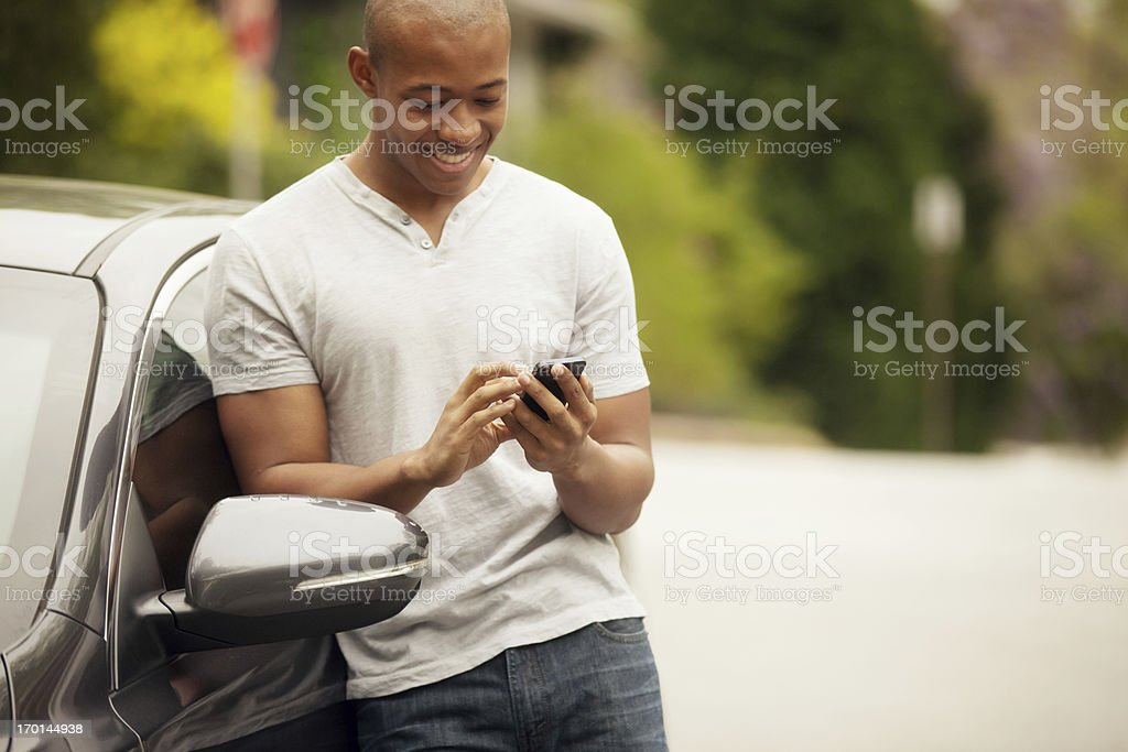 young man texting stock photo