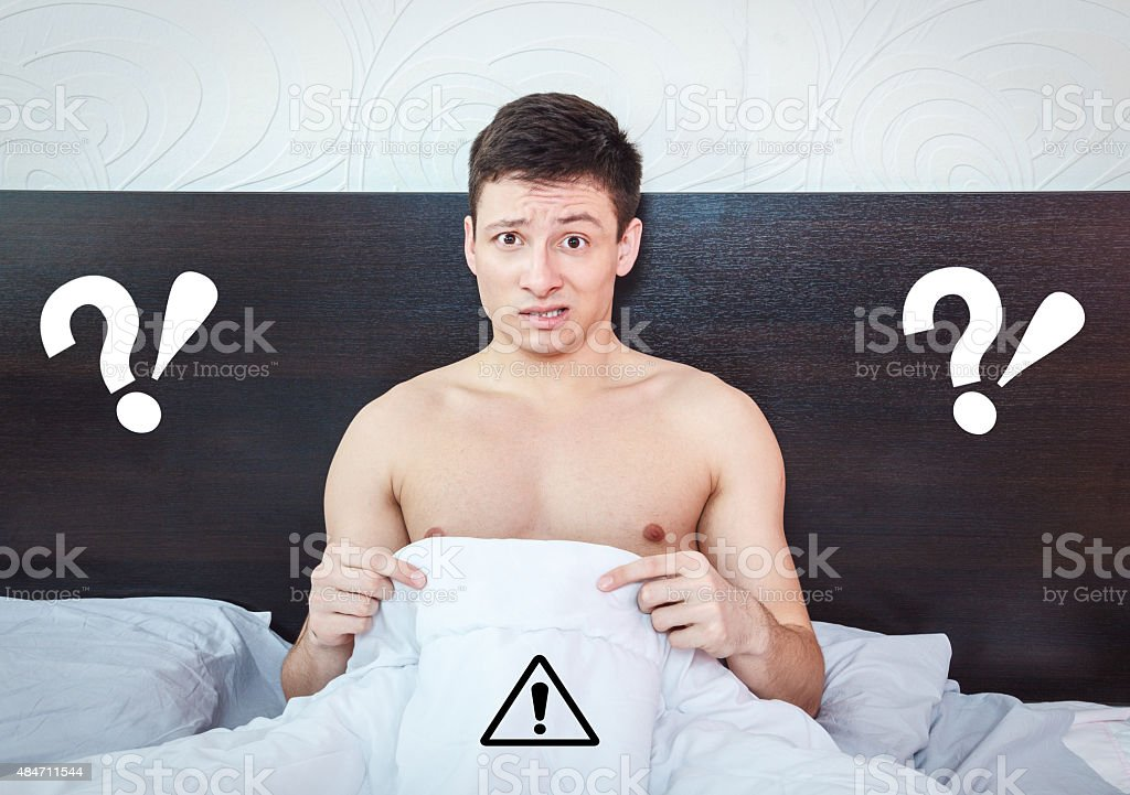 Young man thinking about impotency problems and prostate stock photo