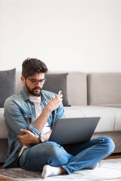 Young man thinking about situation on his bank account. stock photo