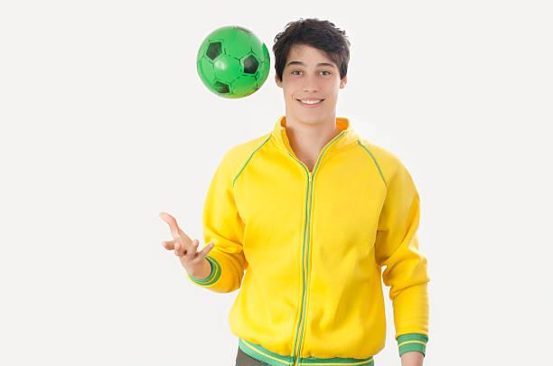 Young man throwing a football ball. stock photo
