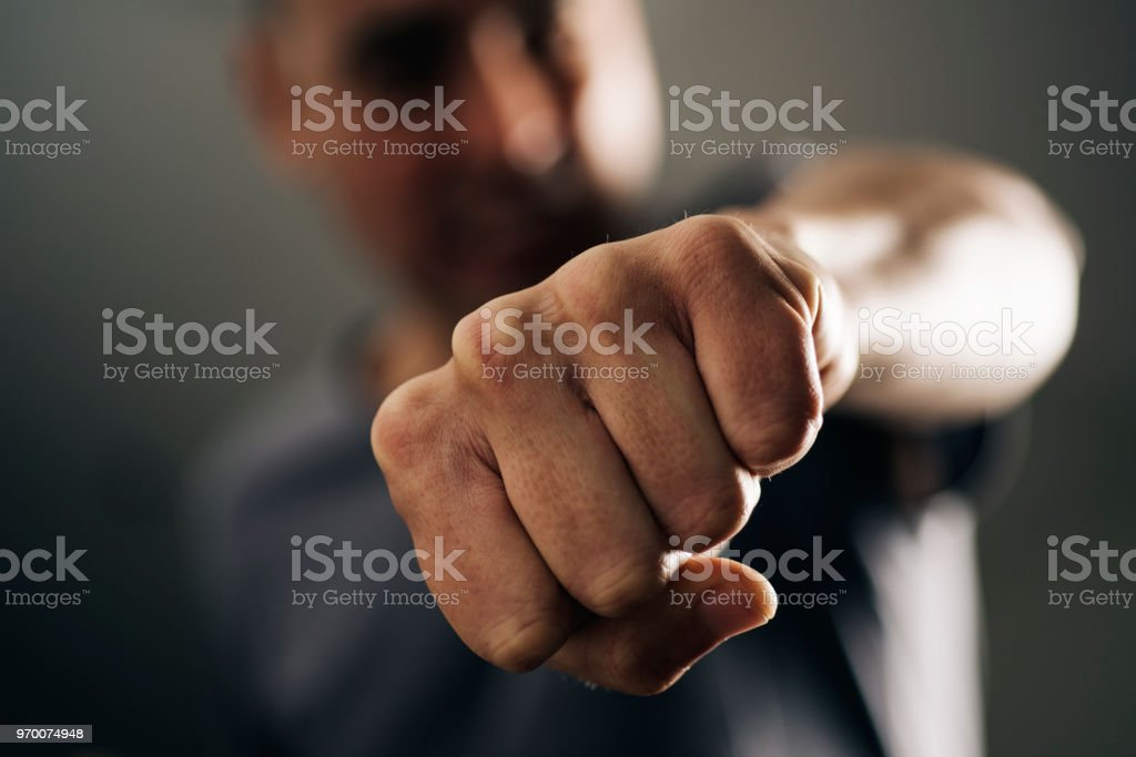 young man throwing a punch stock photo