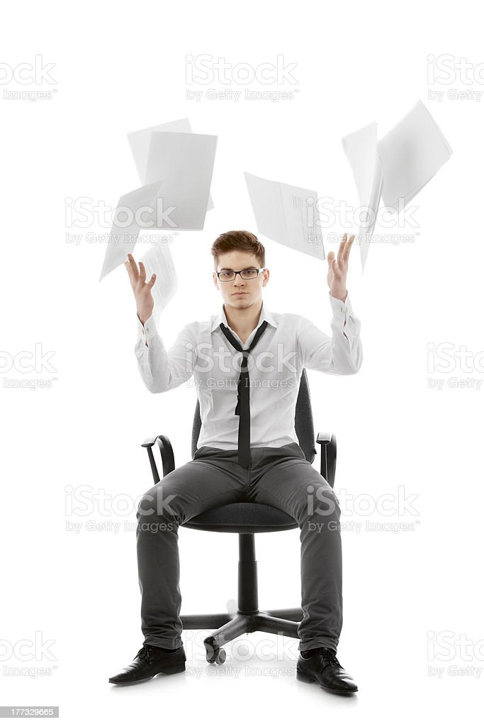 Young man throwing paper stock photo