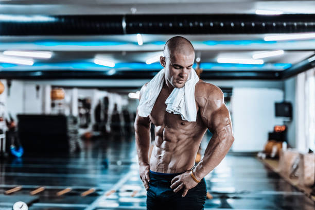 young man tired after training showing his abdominal muscles - milan2099 stock photos and pictures