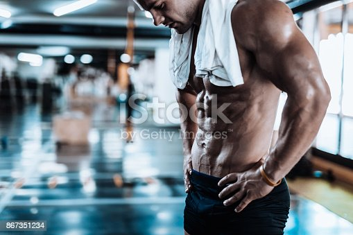 istock Young man tired after training showing his abdominal muscles 867351234