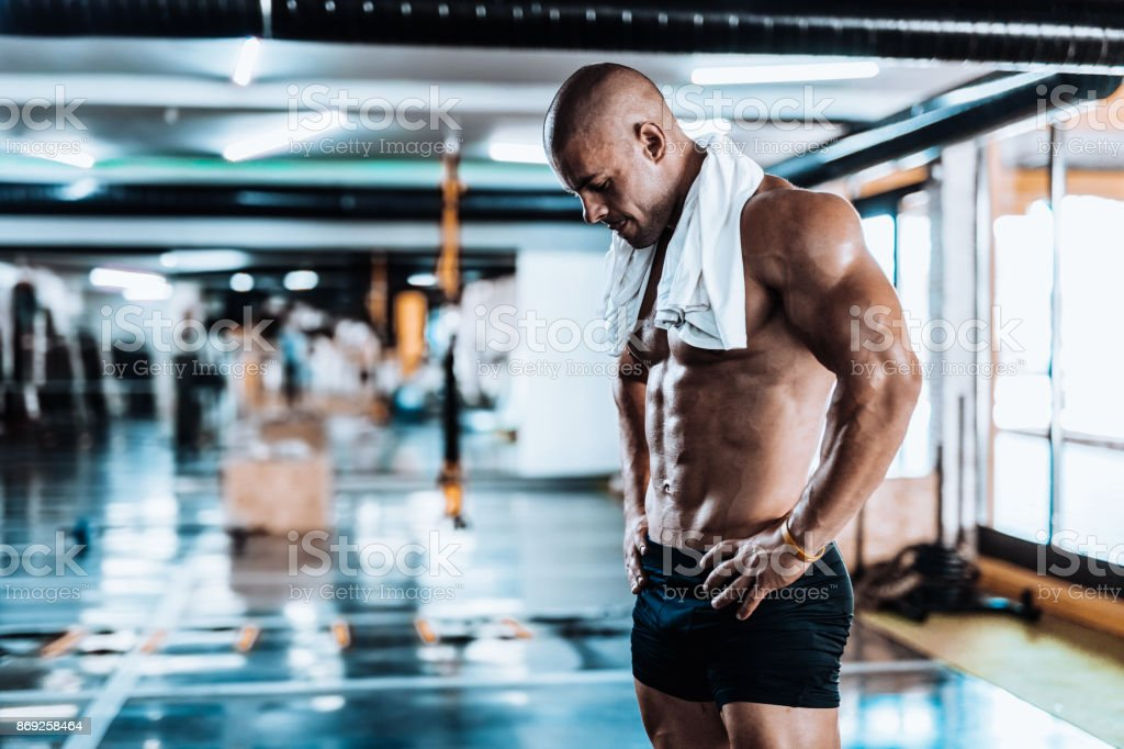 Young man tired after training showing his abdominal muscles stock photo
