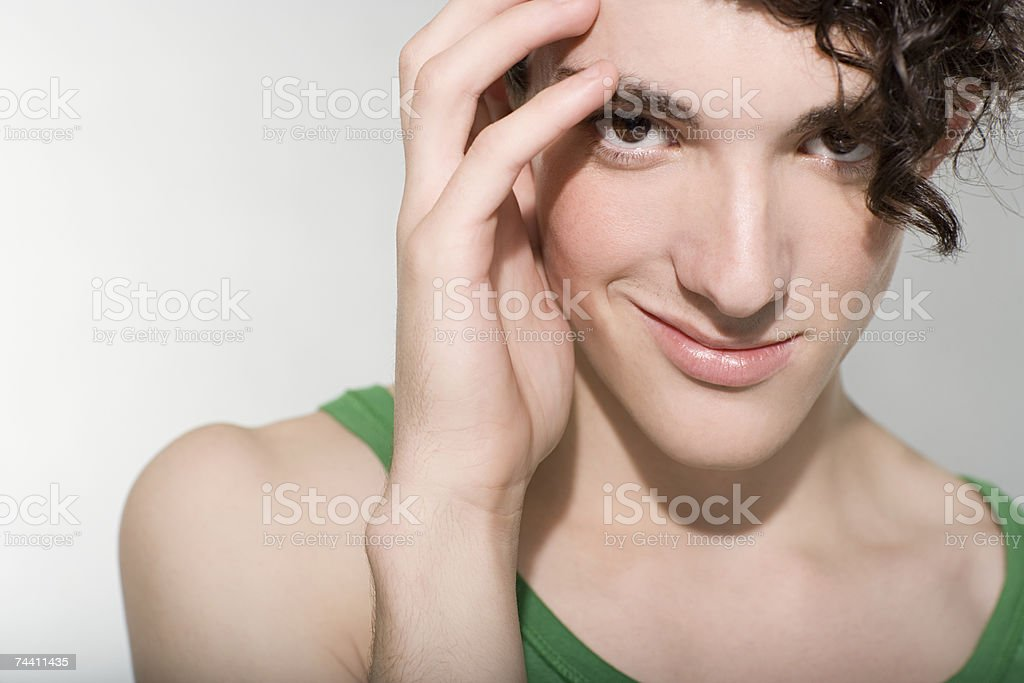 Young man touching his face foto de stock royalty-free