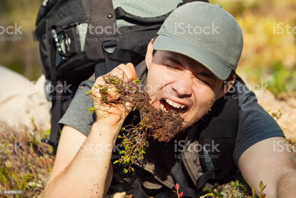 Young man tourist surviving stock photo