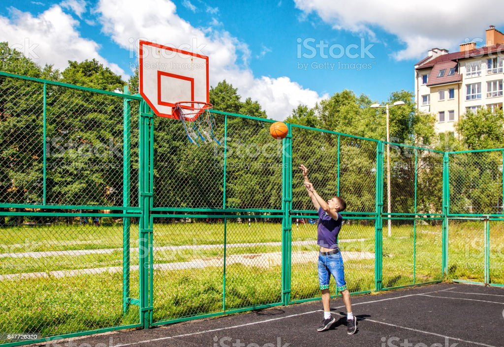 young man training in basketball stock photo