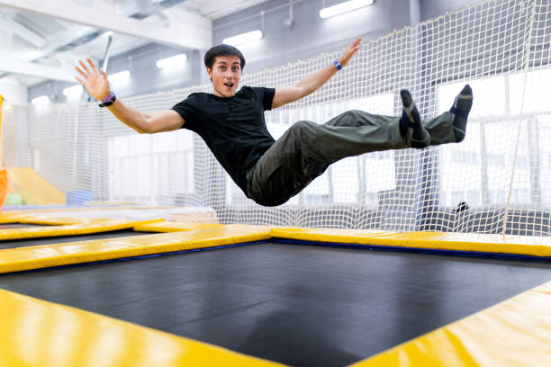 A young man trampolining in fly park stock photo