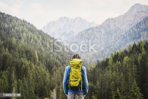 Young men traveler on a walking route, active lifestyle, hiking and travel concept. Man enjoying nature