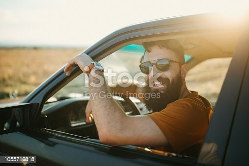 Photo of young man traveling by car in nature
