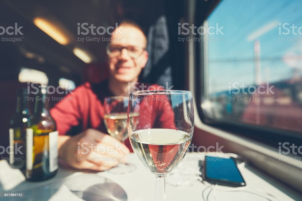 Young man traveling by train stock photo