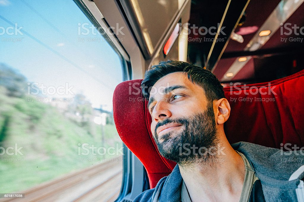 Young Man Traveling In Train stock photo