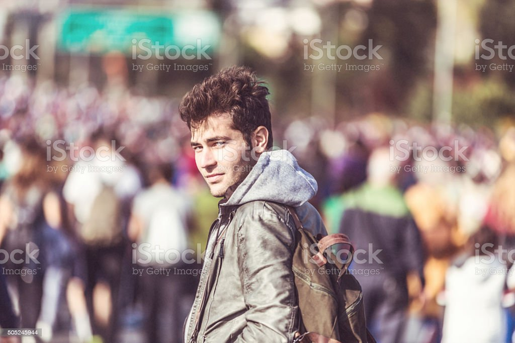 Young Man Travelling on Road stock photo