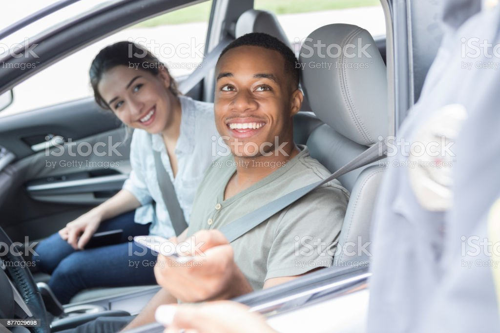 Young man tries to get out of speeding ticket stock photo