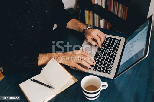 istock Young man typing at the laptop 517156688