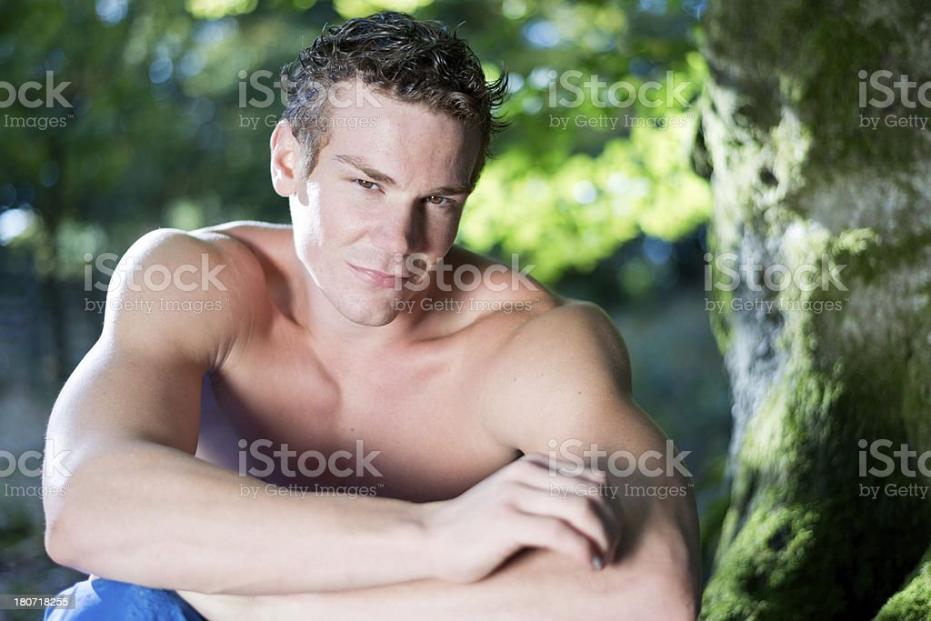 young man under a tree stock photo