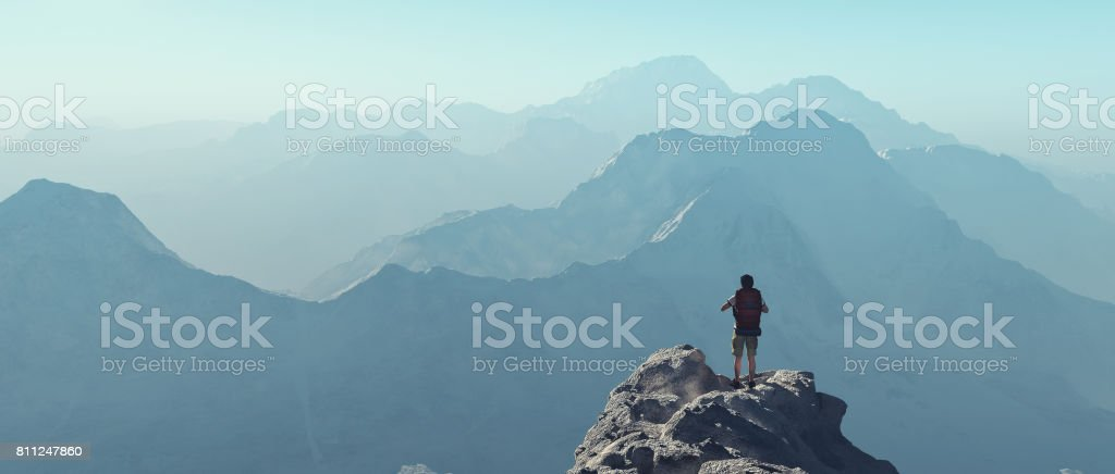 Young man up the mountain stock photo