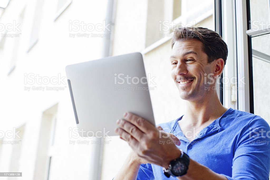 Young man usiing tablet stock photo