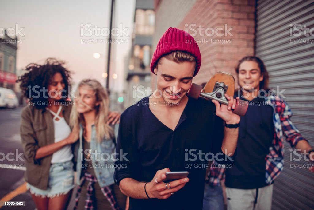 Young man using a phone stock photo