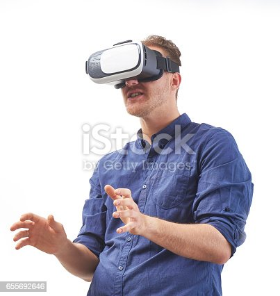 istock young man using a VR headset  enjoying interactive game with fear emotion and experiencing virtual reality isolated on white background studio shot 655692646