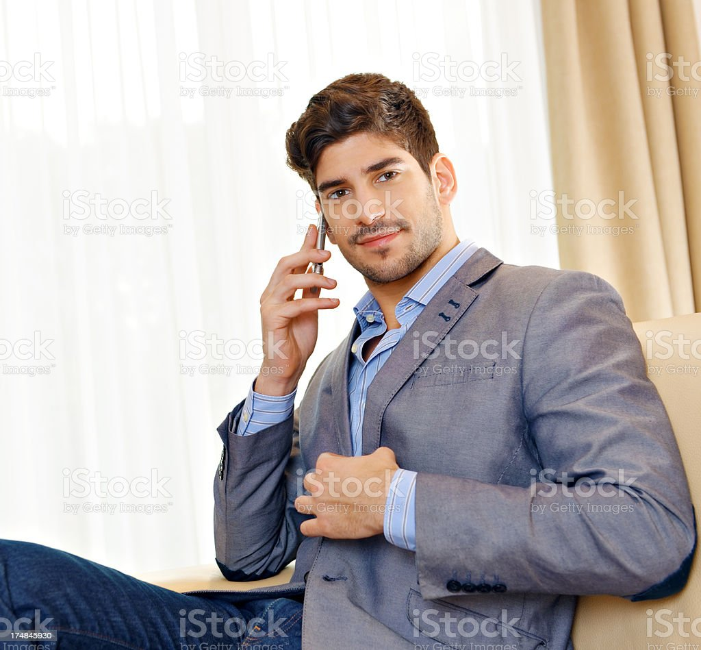 Young man using cell phone royalty-free stock photo