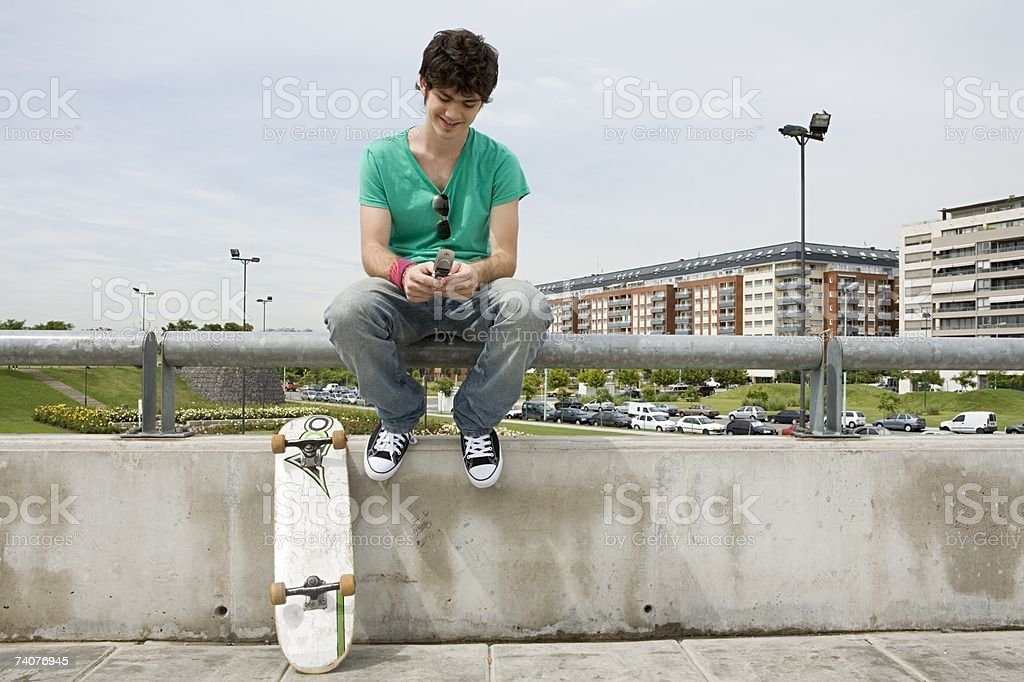 Young man using cellphone stock photo