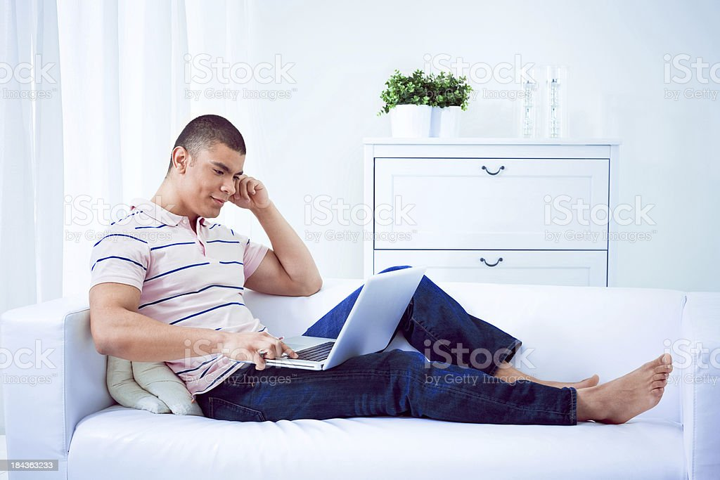 Young man using computer royalty-free stock photo