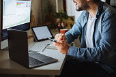 istock Young man using desktop pc at desk in home office 1310342482