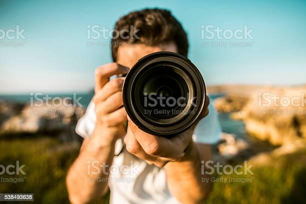Young man using dslr camera picture id538493638?b=1&k=6&m=538493638&s=612x612&h=pyhma bu60s0rj2pcn7p6v3hn0lasphecgz63rqlj9q=