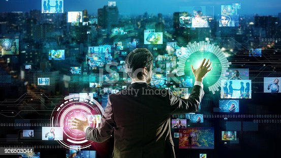 810397364 istock photo Young man using futuristic graphical user interface. 926503044