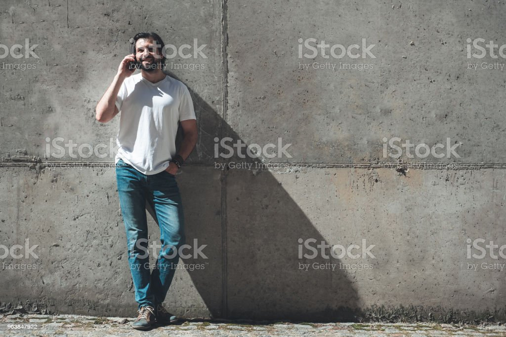 Young man using gadget on the street for communication - Royalty-free Adult Stock Photo