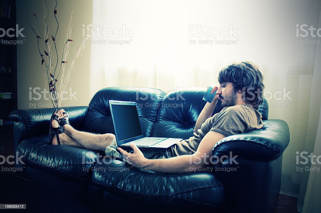 young man using laptop and credit card royalty-free stock photo