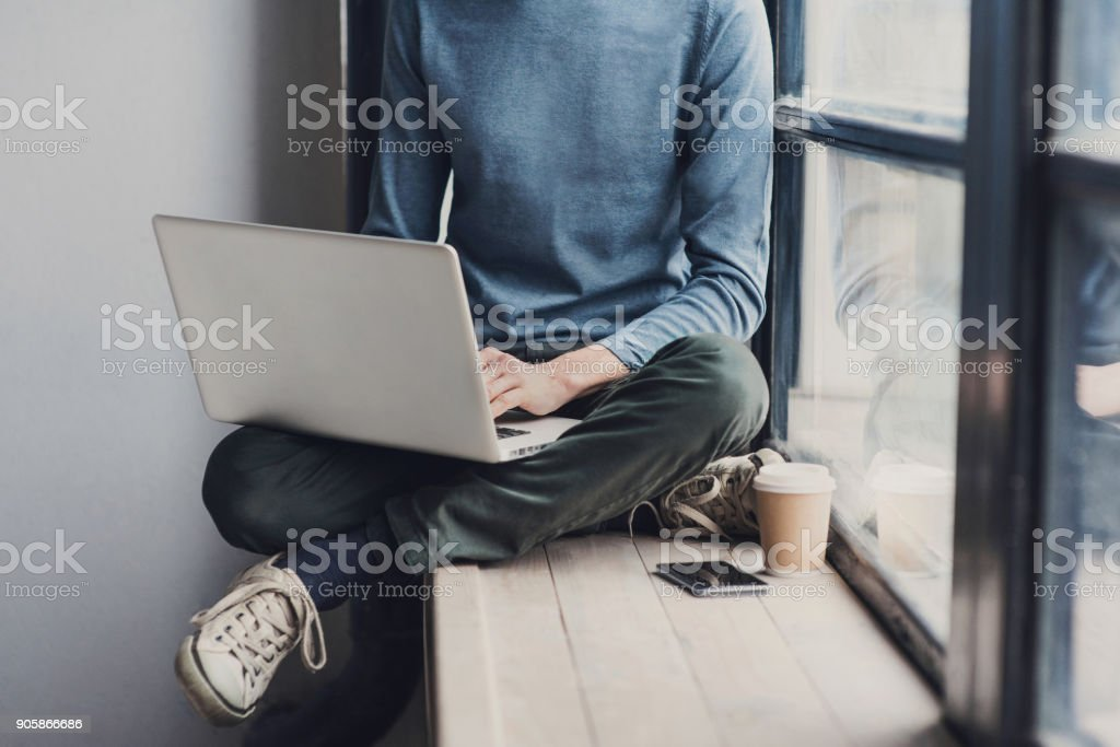 Young man using laptop computer stock photo
