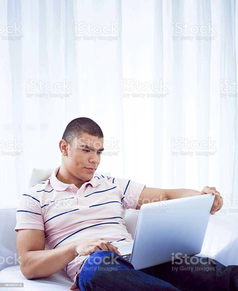 Young man using laptop royalty-free stock photo