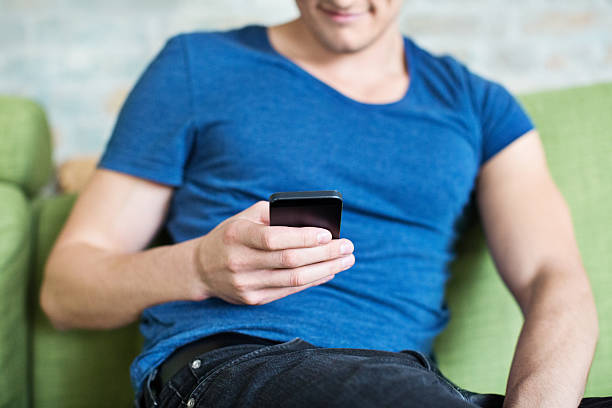 Young man using mobile phone stock photo
