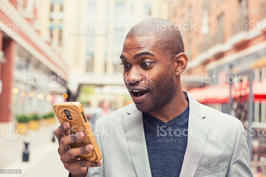 Young man using smart phone. stock photo