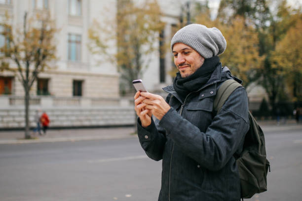 Young man using smartphone in Berlin stock photo