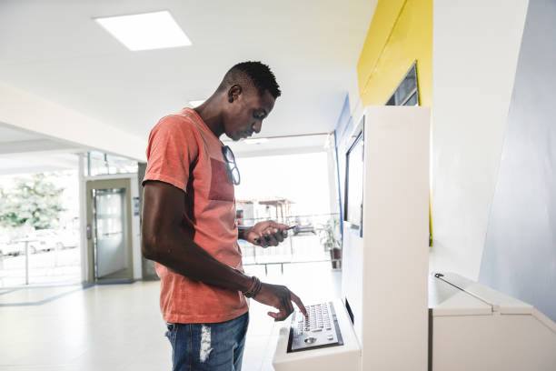 Young man using the self-service system Young man using the self-service system banks and atms stock pictures, royalty-free photos & images