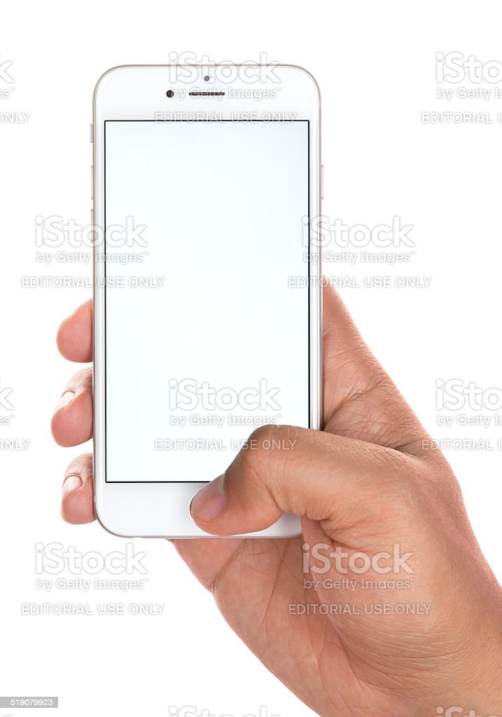 Young Man Using Touch ID on Apple iPhone 6 Silver stock photo