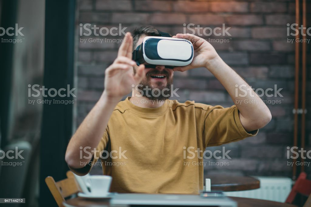 Young man using virtual reality box stock photo