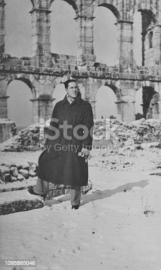 Young man visiting Colosseum in Rome in 1939