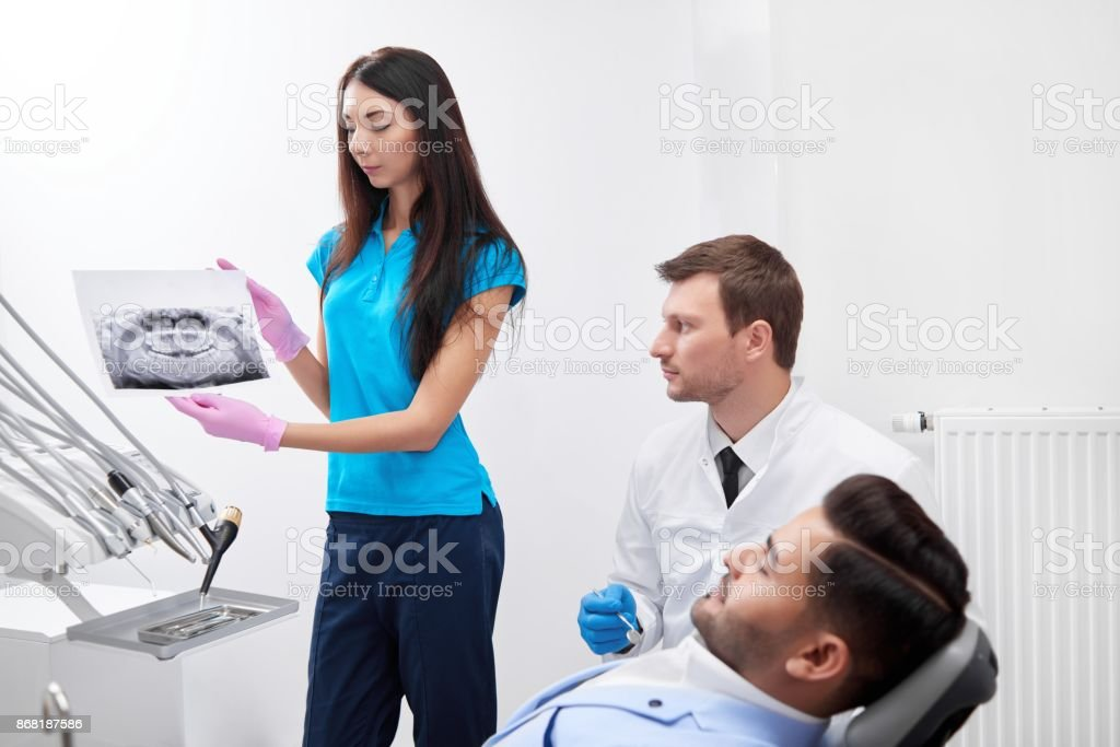 Young man visiting dentist stock photo