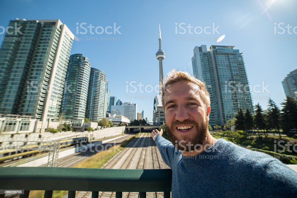 Young man visiting Toronto takes selfie portrait stock photo