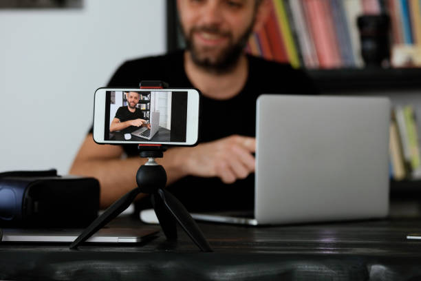 Young man vlogging stock photo