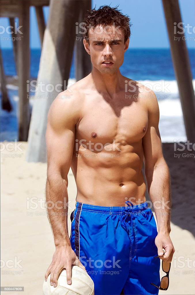 Young Man Volleyball Player on Beach stock photo