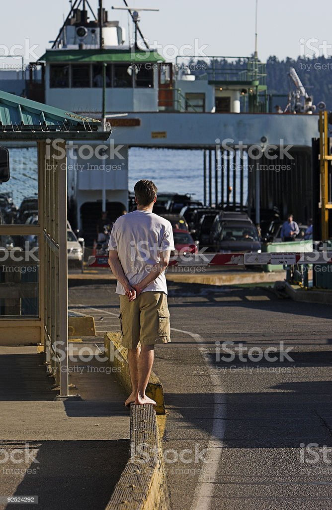 Young man waiting for a car ferry royalty-free stock photo