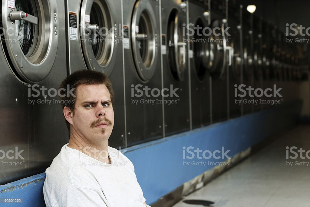 Young Man Waiting for his Laundry royalty-free stock photo