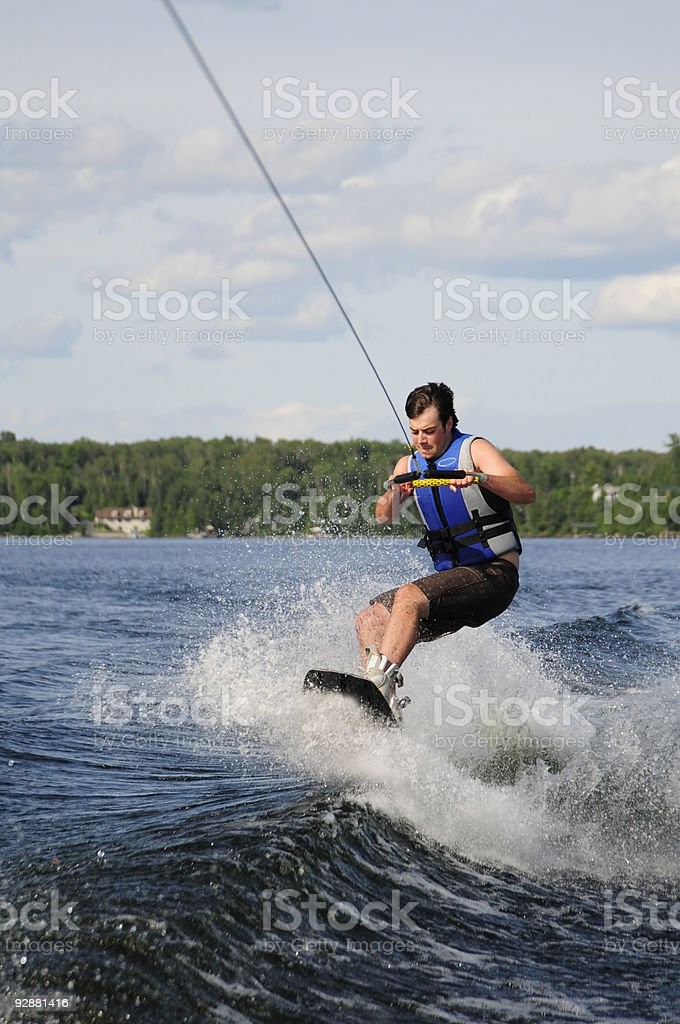 Young man wakeboarding concentrates hard looking intense. royalty-free stock photo