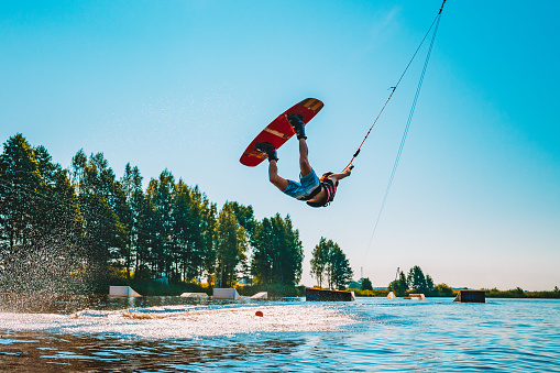 Young man wakeboarding on a lake